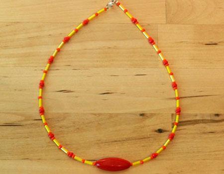 Yellow, orange and big, read bead